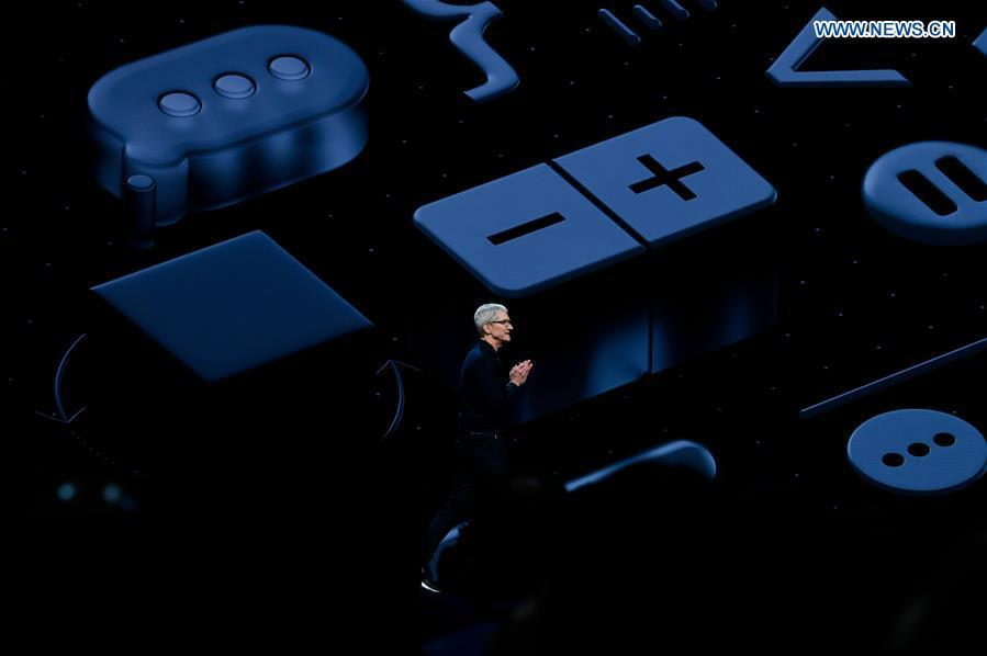 Apple CEO Tim Cook takes the stage during Apple\'s Worldwide Developer Conference (WWDC) at the San Jose Convention Center in San Jose, California, the United States, June 4, 2018. (Xinhua)