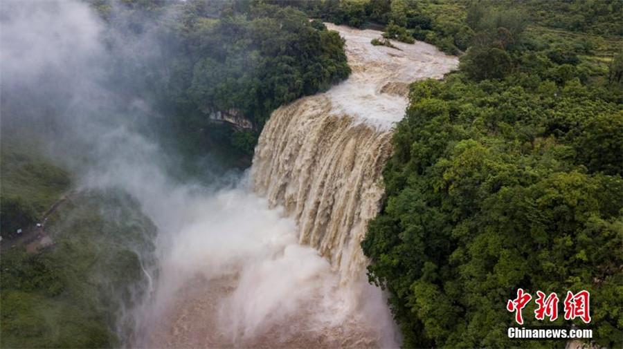 An aerial view of Huangguoshu Waterfall as biggest flow of the year thunders down in Anshun city, Southwest China\'s Guizhou Province, June 4, 2018. The water flow reached 290 cubic meters per second due to heavy rainfall in the region. (Photo/China News Service)
