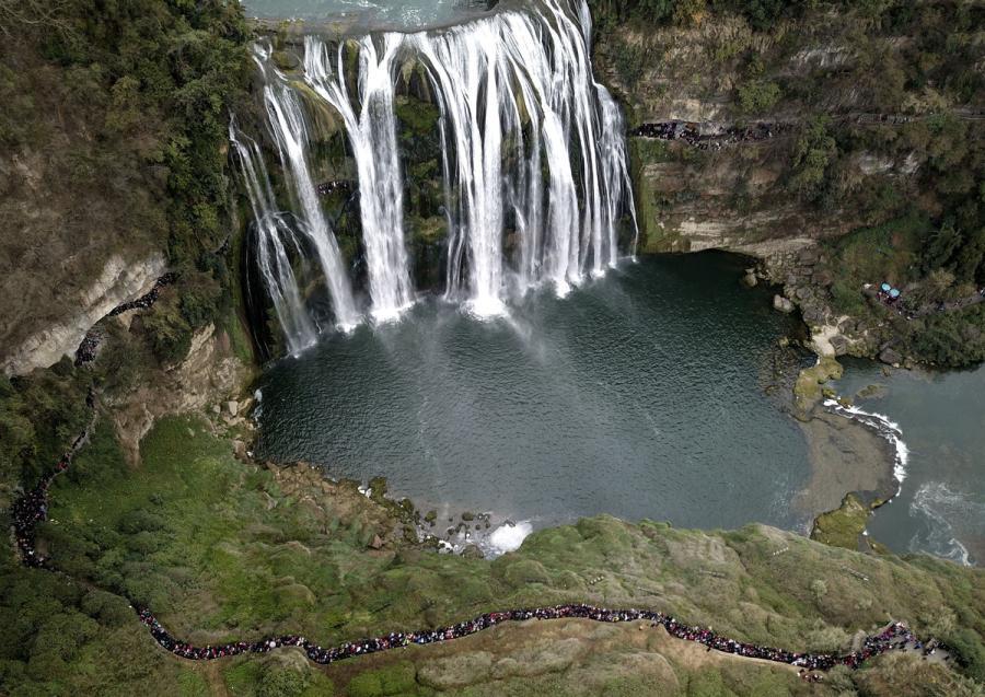 An aerial view of tourists visiting Huangguoshu Waterfall on Feb. 21, 2018. (Photo/Xinhua)