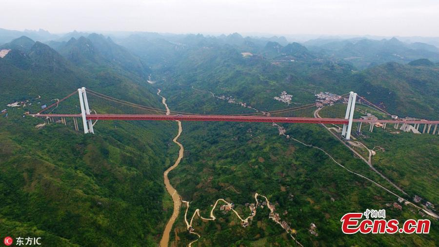 A drone photo shows the Baling River Bridge over a valley in Guanling County, Southwest China's Guizhou Province, June 5, 2018. At a height of 370 meters above the water, the 1,564-meter-long suspension bridge is the second highest bridge in China and the sixth highest in the world. The bride is unique for having a span of 1,088 meters. (Photo/IC)