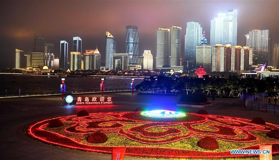Panorama photo taken on June 2, 2018 shows the night view of Wusi Square in Qingdao, east China\'s Shandong Province. The 18th Shanghai Cooperation Organization (SCO) Summit is scheduled for June 9 to 10 in Qingdao. (Xinhua/Yin Gang)