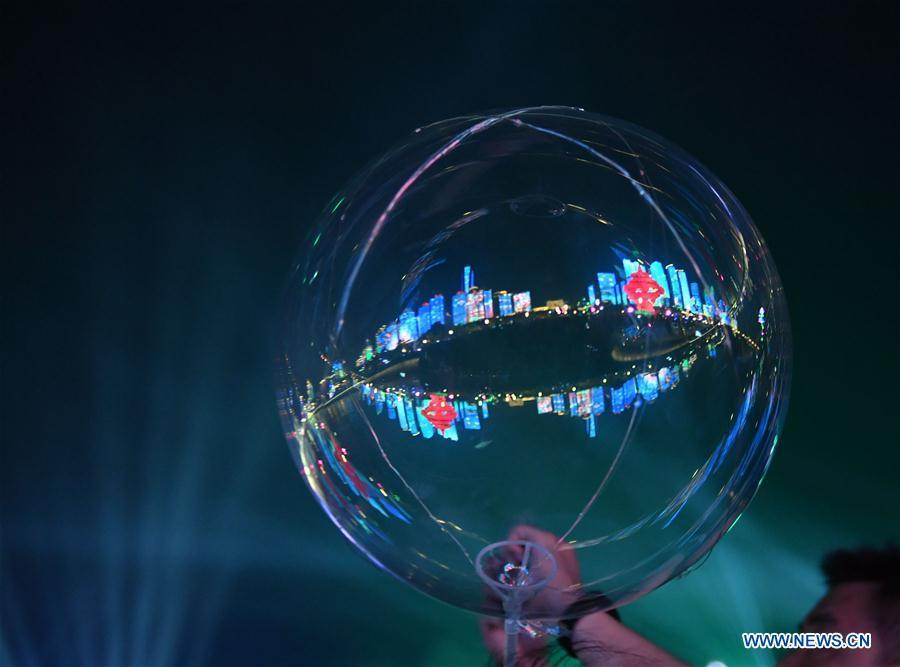 Photo taken on June 1, 2018 shows the reflection of Wusi Square on a balloon in Qingdao, east China\'s Shandong Province. The 18th Shanghai Cooperation Organization (SCO) Summit is scheduled for June 9 to 10 in Qingdao. (Xinhua/Jin Liangkuai)