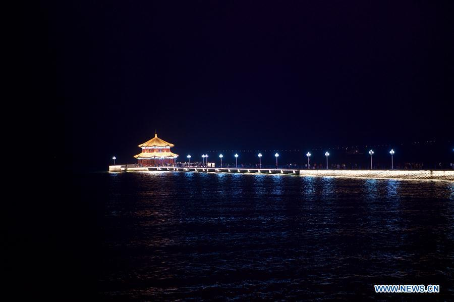 Photo taken on June 4, 2018 shows the night view of Zhanqiao Pier in Qingdao, east China\'s Shandong Province. The 18th Shanghai Cooperation Organization (SCO) Summit is scheduled for June 9 to 10 in Qingdao. (Xinhua/Jiang Kehong)