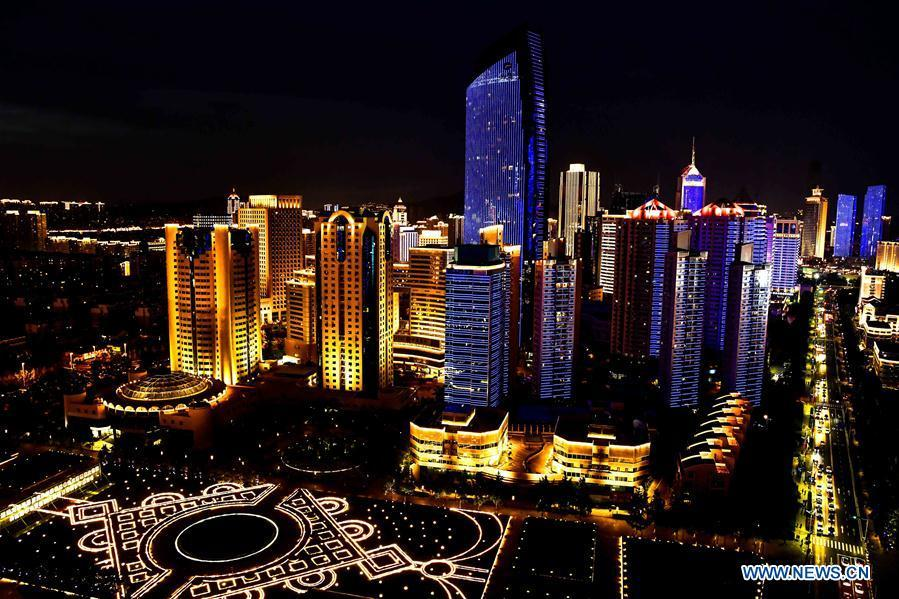 Photo taken on June 2, 2018 shows the night view near Wusi Square in Qingdao, east China\'s Shandong Province. The 18th Shanghai Cooperation Organization (SCO) Summit is scheduled for June 9 to 10 in Qingdao. (Xinhua/Guo Xulei)