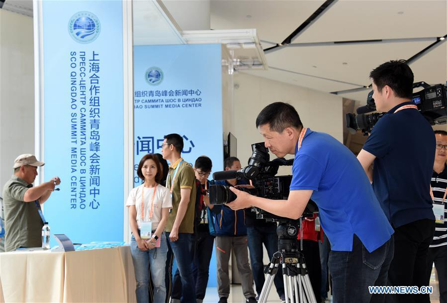 A cameraman works at the media center for the 18th Shanghai Cooperation Organization (SCO) Summit in Qingdao, east China\'s Shandong Province, June 6, 2018. The center will be open to journalists from both home and abroad from June 6 to 11. (Xinhua/Li Ziheng)