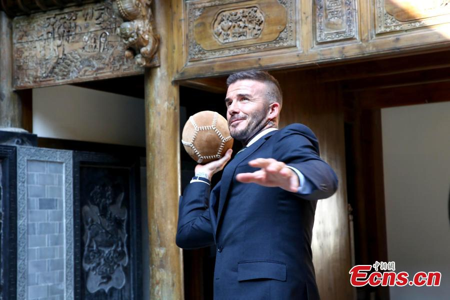 Former professional football star David Beckham plays cuju, known as the origin of modern football, at the Bengbu Ancient Buildings Expo Park ahead of the 2018 G-EXPO Global Top Summit in Bengbu City, East China's Anhui Province, June 6, 2018. (Photo: China News Service/Zhong Xin)