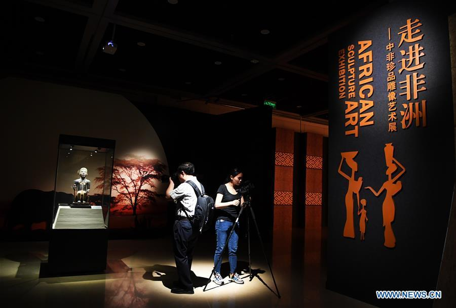 Journalists take photos at the African Art Exhibition in southwest China\'s Chongqing, June 7, 2018. The exhibition will open to the public from June 8 to Sept. 9. (Xinhua/Wang Quanchao)