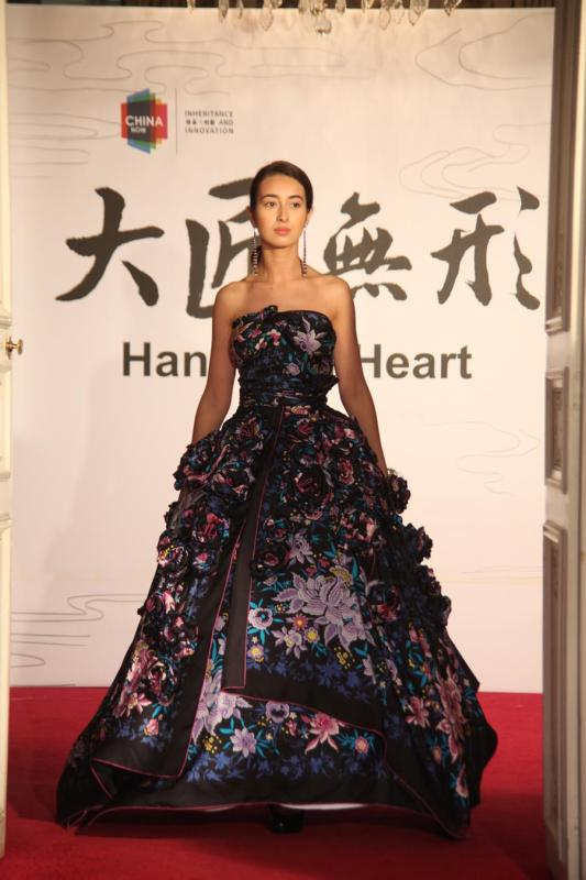 A model shows a silk flower dress at the Paris China Cultural Center on June 5, 2018. (Photo provided to Chinaculture.org)
