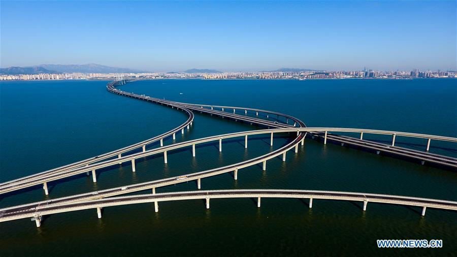 Aerial photo taken on June 1, 2018 shows the Qingdao Jiaozhou Bay Bridge in Qingdao, east China\'s Shandong Province. The 36.48-km cross-sea bridge connects the urban district of Qingdao City to its Huangdao district. (Xinhua/Guo Xulei)
