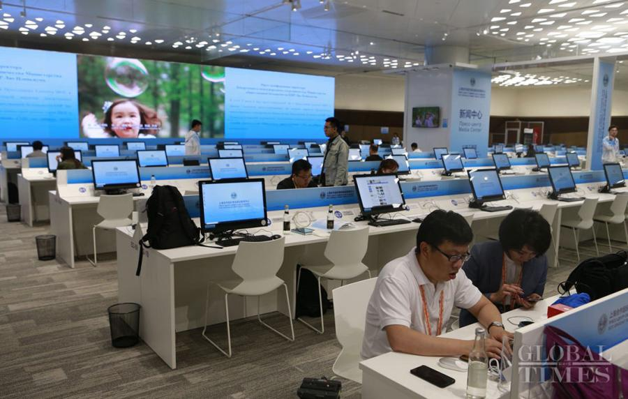 Journalists prepare in the media center of the Shanghai Cooperation Organization Qingdao Summit in Qingdao, East China\'s Shandong Province, on June 7, 2018. (Photo: Li Hao/GT)