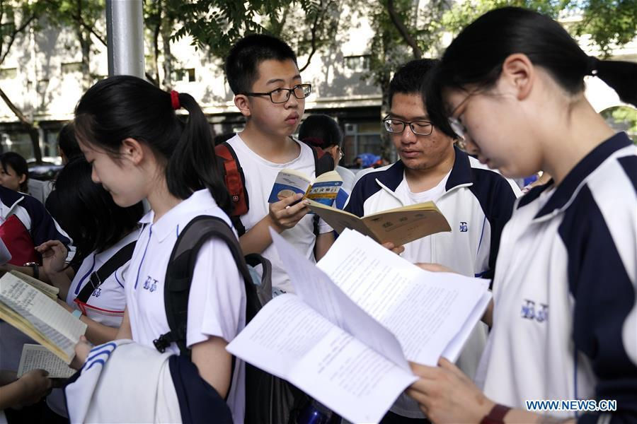 Examinees review before the exam at the Beijing No. 4 Middle School in Beijing, capital of China, June 7, 2018. About 9.75 million students have registered for the national college entrance examination, which takes place from June 7 to 8. (Xinhua/Shen Bohan)