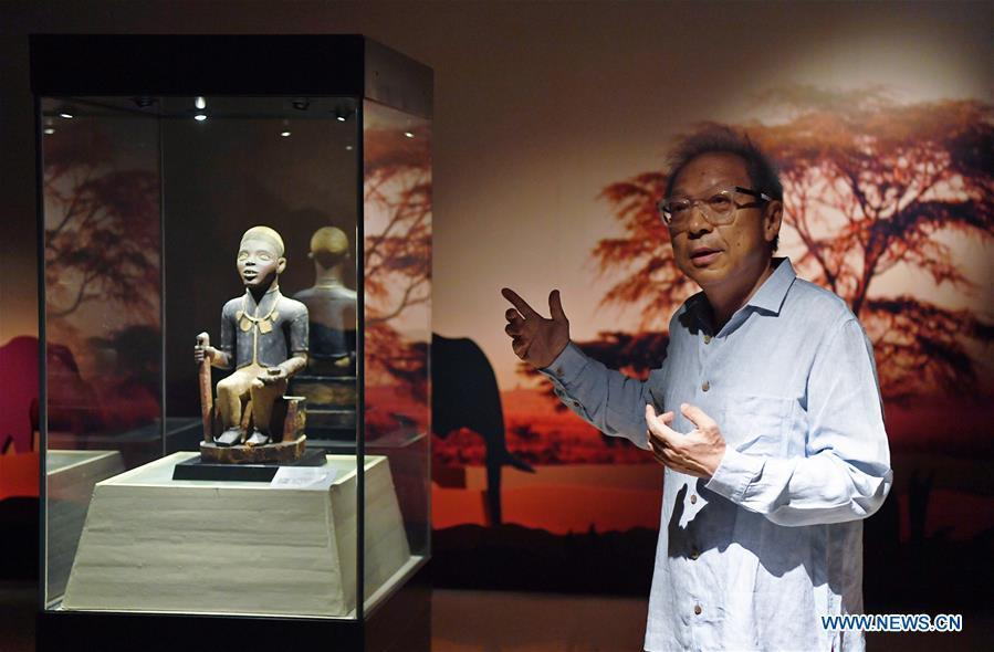 A curator introduces the African Art Exhibition held in southwest China\'s Chongqing, June 7, 2018. The exhibition will open to the public from June 8 to Sept. 9. (Xinhua/Wang Quanchao)
