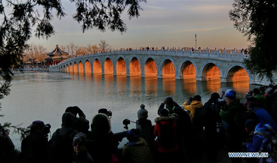 Photo taken on Nov. 29, 2017 shows twilight through the Seventeen Arch Bridge in the Summer Palace in Beijing, capital of China. (Xinhua/Liu Xianguo)