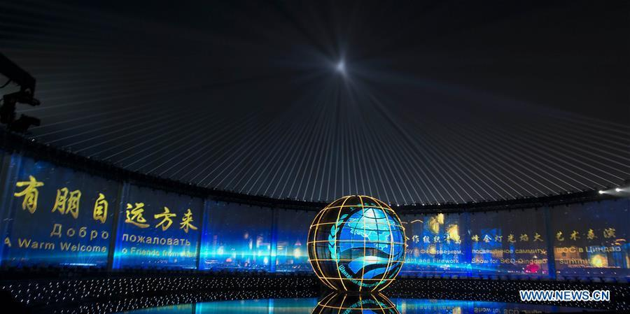A lights and fireworks show takes place in Qingdao, the host city of the 18th Shanghai Cooperation Organization (SCO) summit, in east China\'s Shandong Province, June 9, 2018. (Xinhua/Li Xueren)
