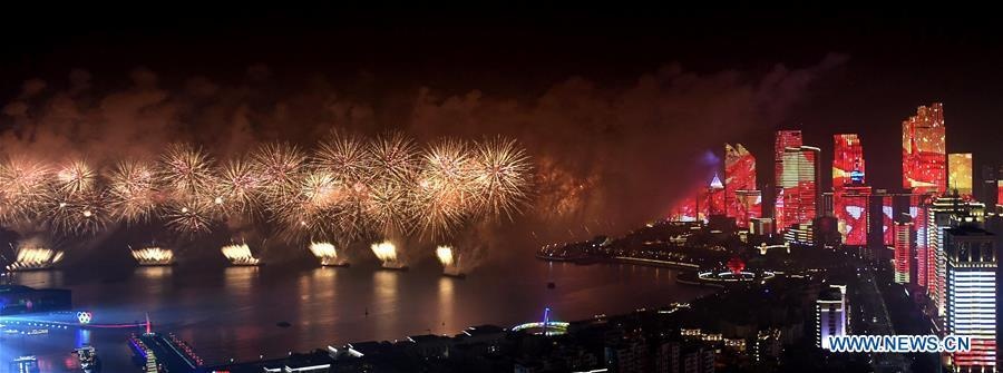 A lights and fireworks show takes place in Qingdao, the host city of the 18th Shanghai Cooperation Organization (SCO) summit, in east China\'s Shandong Province, June 9, 2018. (Xinhua/Li Ziheng)