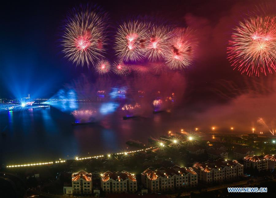 A lights and fireworks show takes place in Qingdao, the host city of the 18th Shanghai Cooperation Organization (SCO) summit, in east China\'s Shandong Province, June 9, 2018. (Xinhua/Jiang Kehong)