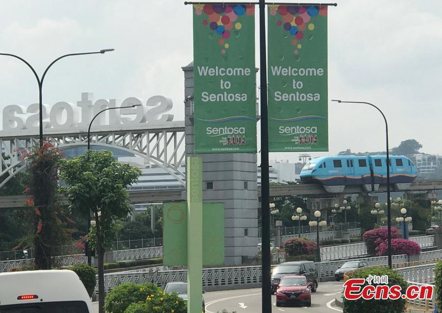 A tram runs on Sentosa Island, Asia\'s leading leisure destination and Singapore\'s premier island getaway, June 10, 2018. (Photo: China News Service/Meng Xiangjun)