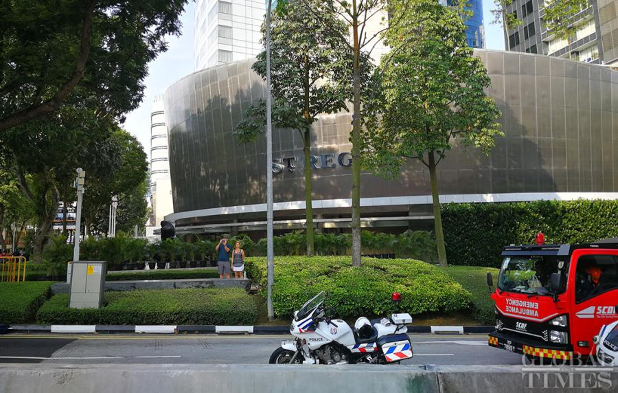 Police and emergency vehicles sit outside the St. Regis Hotel on Sunday where DPRK leader Kim Jong-un is staying. (Photo: Yang Sheng/GT)