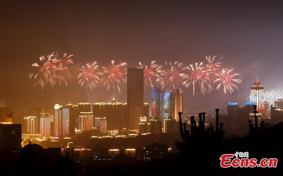 A light show and fireworks display is held to welcome guests attending the 18th Shanghai Cooperation Organization (SCO) Summit in Qingdao, Shandong Province, June 9, 2018. (Photo: China News Service/Du Yang)