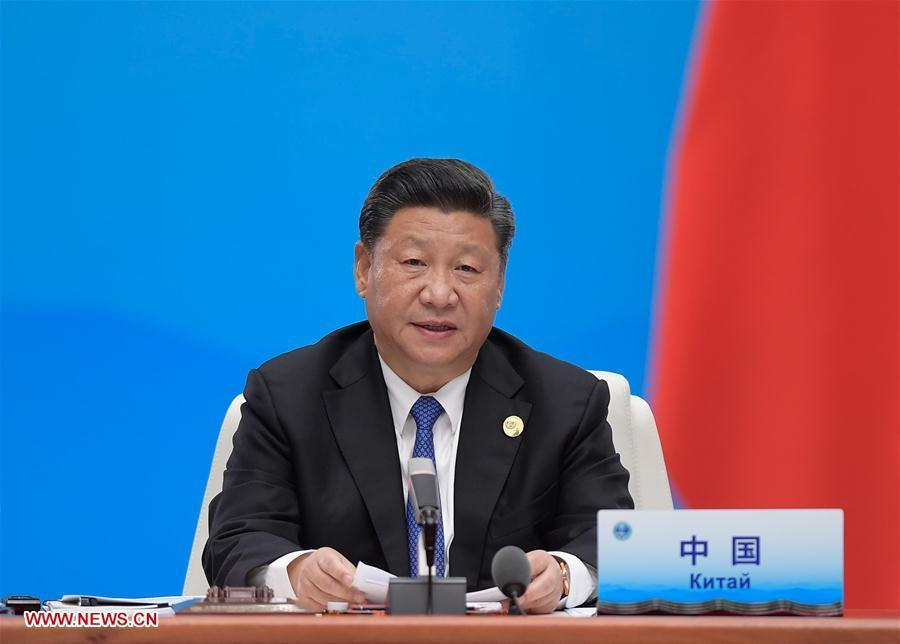 Chinese President Xi Jinping chairs the 18th Meeting of the Council of Heads of Member States of the Shanghai Cooperation Organization (SCO) in Qingdao, east China\'s Shandong Province, June 10, 2018. Xi delivered a speech during the meeting. (Xinhua/Li Xueren)