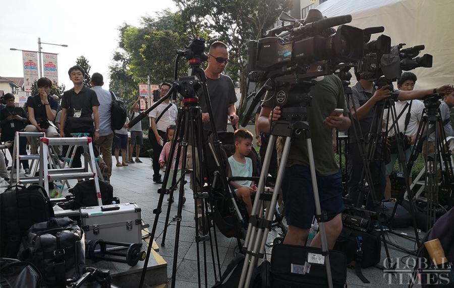 Journalists prepare outside the St. Regis hotel where DPRK leader Kim Jong-un has stayed in Singapore on Sunday. (Photo: Yang Sheng/GT)