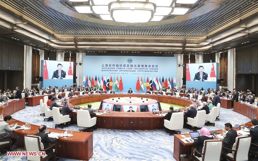 The 18th Meeting of the Council of Heads of Member States of the Shanghai Cooperation Organization (SCO) is held in Qingdao, east China\'s Shandong Province, June 10, 2018. Chinese President Xi Jinping chaired the meeting and delivered a speech. (Xinhua/Ding Lin)