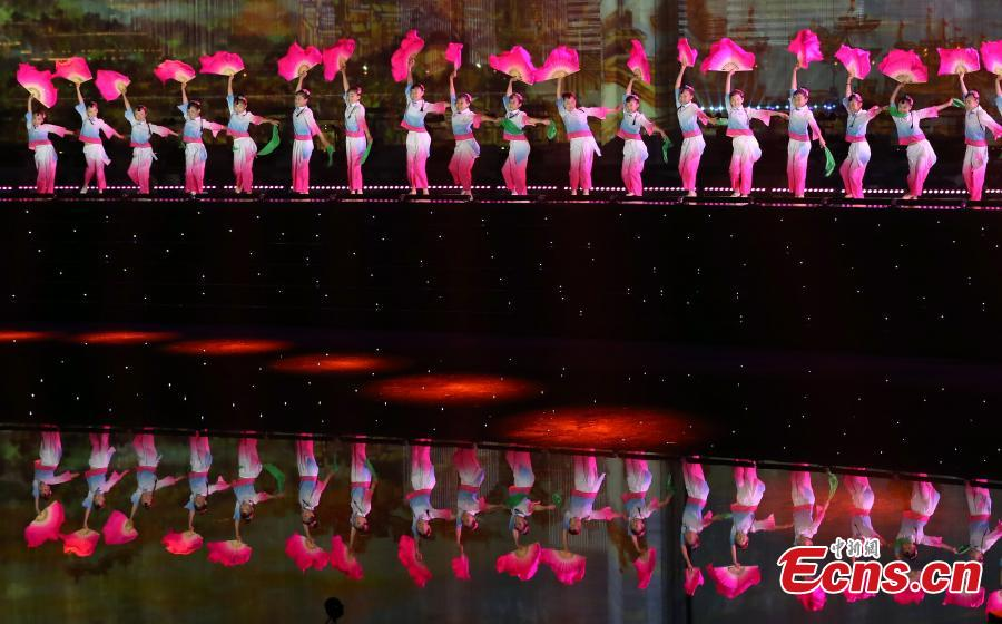 Dancers perform during a light show and fireworks display held to welcome guests attending the 18th Shanghai Cooperation Organization (SCO) Summit in Qingdao, Shandong Province, June 9, 2018. (Photo: China News Service/Mao Jianjun)