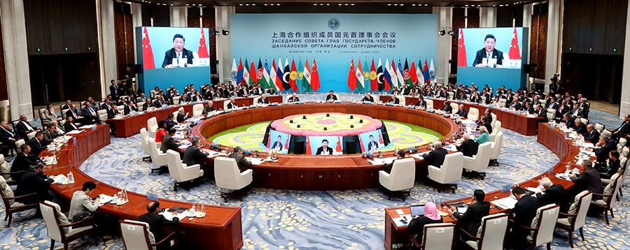 President Xi Jinping delivers a speech at the 18th Meeting of the Council of Heads of Member States of the Shanghai Cooperation Organization in Qingdao, Shandong Province, on Sunday.  (Photo/China Daily)