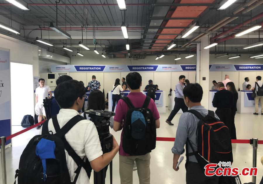 Reporters gather at the International Media Center for the DPRK-USA summit at F1 Pit Building in Singapore, June 10, 2018. (Photo: China News Service/Meng Xiangjun)