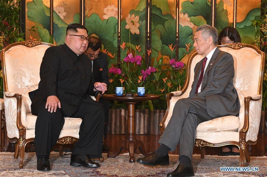 Singaporean Prime Minister Lee Hsien Loong (R) meets with Kim Jong Un, chairman of the Workers\' Party of Korea (WPK) and chairman of the State Affairs Commission of the Democratic People\'s Republic of Korea (DPRK), in Singapore, on June 10, 2018. (Xinhua/Then Chih Wey)