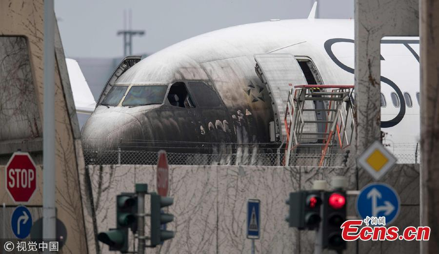 A plane of the Star Alliance is damaged after a push-car caught fire at the airport in Frankfurt, Germany, June 11, 2018. German airline Lufthansa says 10 airport workers have suffered minor injuries from smoke inhalation when a vehicle pulling a jet to a gate caught on fire. (Photo/Agencies)