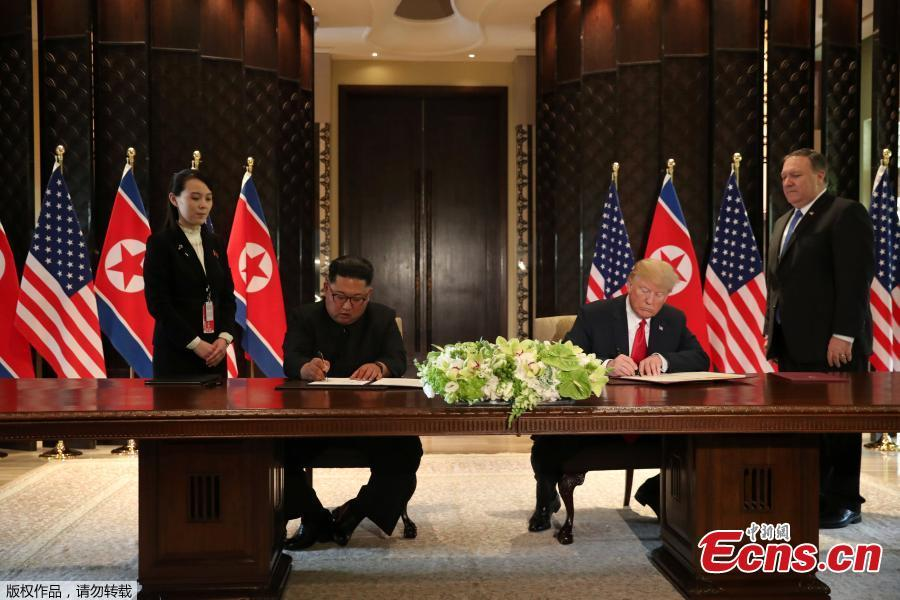 U.S. President Donald Trump (R) and top leader of the Democratic People\'s Republic of Korea (DPRK) Kim Jong Un sign documents that acknowledge the progress of the talks and pledge to keep momentum going, after their summit at the Capella Hotel on Sentosa island in Singapore, June 12, 2018. Trump said it is a \