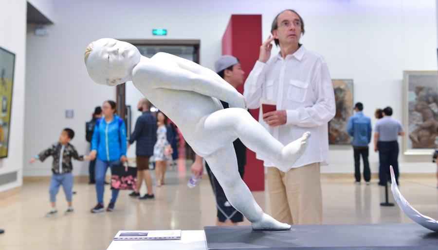 A sculpture on display at the 6th National Youth Art Exhibition in the National Art Museum in Beijing, June 10, 2018. More than 380 art pieces created by young Chinese artists are showcased to reflect the new development and artistic characteristics of contemporary art among young people. Exhibits include Chinese painting, oil painting, printmaking, sculptures, watercolors and illustrations. (Photo/Xinhua)