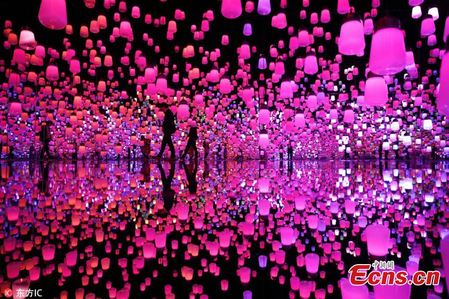 The flower-filled waterfall is the work of Japanese collective teamLab, known internationally for their innovative \
