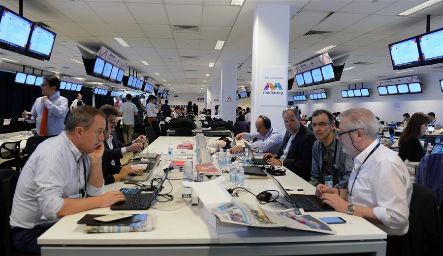 Reporters work at the international media center in Singapore, ahead of the historic summit between top leader of the Democratic People\'s Republic of Korea (DPRK) Kim Jong Un and U.S. President Donald Trump, on June 12, 2018. (Xinhua/Li Peng)