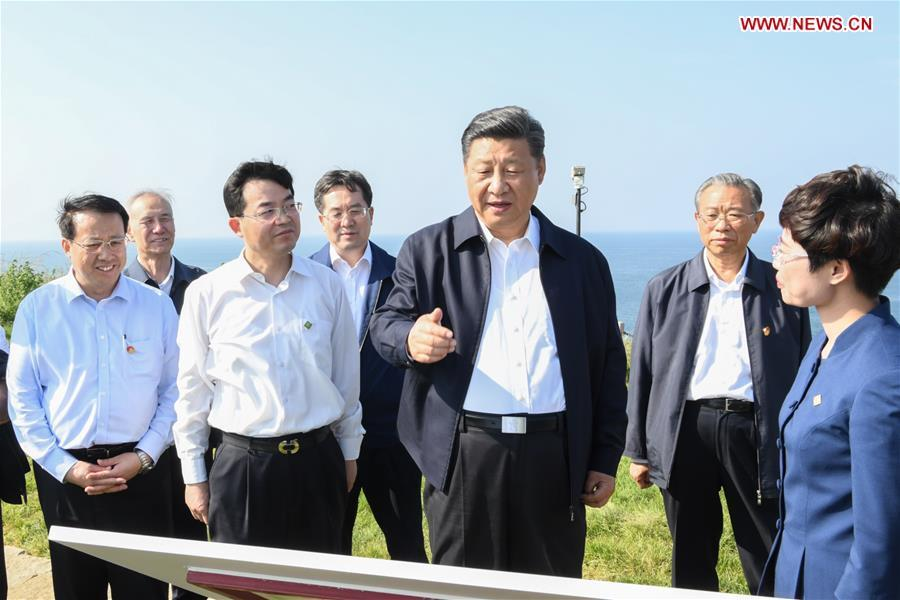 Chinese President Xi Jinping, also general secretary of the Communist Party of China Central Committee and chairman of the Central Military Commission, visits a fort relic site on Liugong Island during an inspection tour in Weihai, east China\'s Shandong Province, June 12, 2018. (Xinhua/Li Xueren)