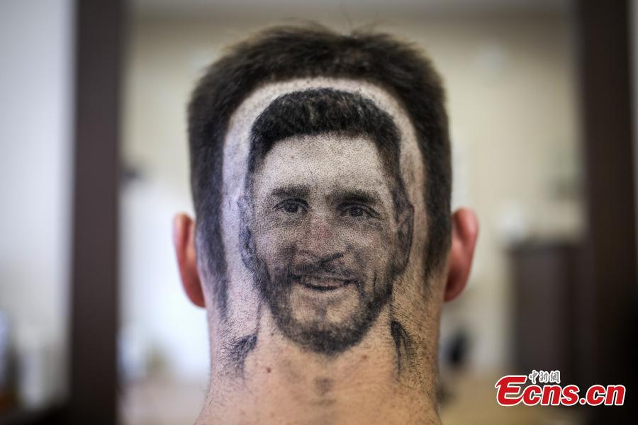 A fan of Lionel Messi shows his new haircut that features the face of the football star in Novi Sad, Serbia ahead of the World Cup. Barber Mario Hvala is famed for his salon in Novi Sad, where he shaves all manner of shapes and faces into customers\' hair. (Photo/Agencies)
