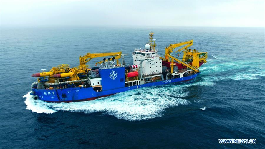 Tian Kun Hao, a Chinese-built dredging vessel, the largest of its kind in Asia, sails under a sea trial after departing a port in east China\'s Jiangsu Province, June 12, 2018. Tian Kun Hao, constructed by Tianjin Dredging Co. Ltd., a subsidiary of China Communication Construction Co., Ltd. (CCCC), finished its first sea trial. The 140-meter-long vessel, with the designed capacity to dredge 6,000 cubic meters per hour, can dig as deep as 35 meters under the sea floor. (Xinhua/Mao Zhenhua)