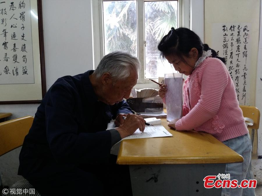 Ye Lianping works in a classroom for left behind children in Maanshan City, East China's Anhui Province. The retired teacher has volunteered to help students learn English for 18 years. The local government helped renovate a storage area into two rooms where students can finish homework, read books and play chess. Ye said many rural children live with their grandparents after their parents migrated to work in other cities. Despite the generous support for students, Ye is known for his thrift and still lives in a shabby cottage built 30 years ago. (Photo/VCG)