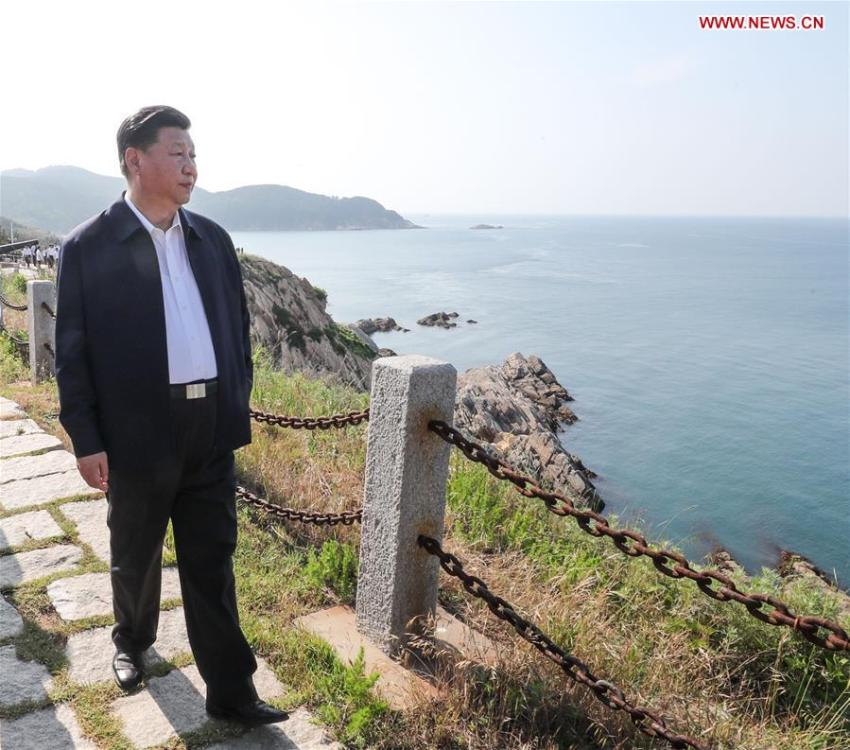 Chinese President Xi Jinping, also general secretary of the Communist Party of China Central Committee and chairman of the Central Military Commission, visits a fort relic site on Liugong Island during an inspection tour in Weihai, east China\'s Shandong Province, June 12, 2018. (Xinhua/Xie Huanchi)