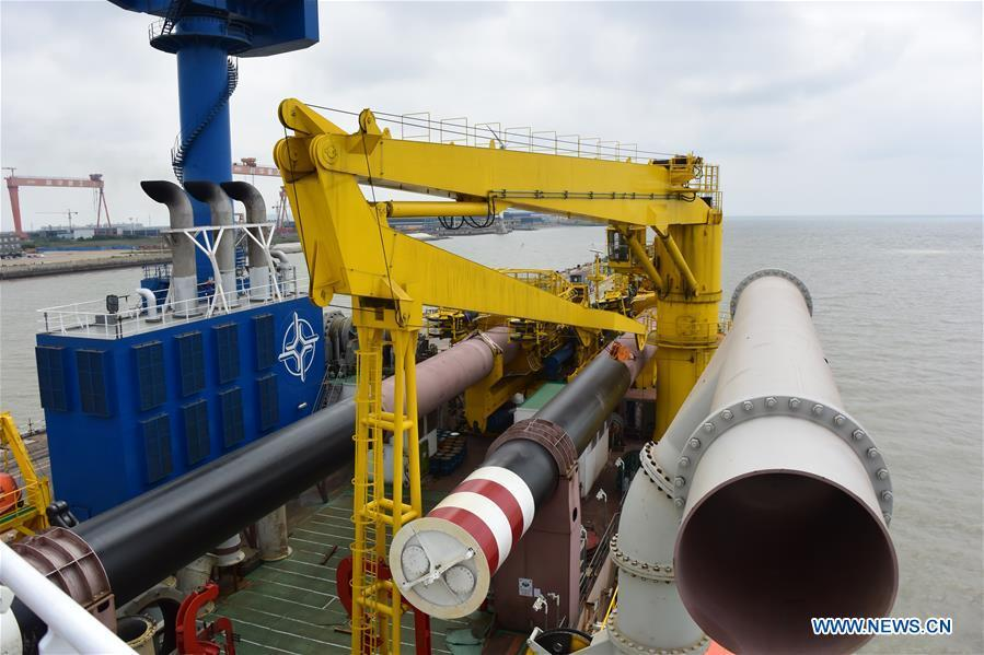 Photo taken on June 7, 2018 shows Tian Kun Hao, a Chinese-built dredging vessel, the largest of its kind in Asia, in east China\'s Jiangsu Province. Tian Kun Hao, constructed by Tianjin Dredging Co. Ltd., a subsidiary of China Communication Construction Co., Ltd. (CCCC), finished its first sea trial. The 140-meter-long vessel, with the designed capacity to dredge 6,000 cubic meters per hour, can dig as deep as 35 meters under the sea floor. (Xinhua/Mao Zhenhua)
