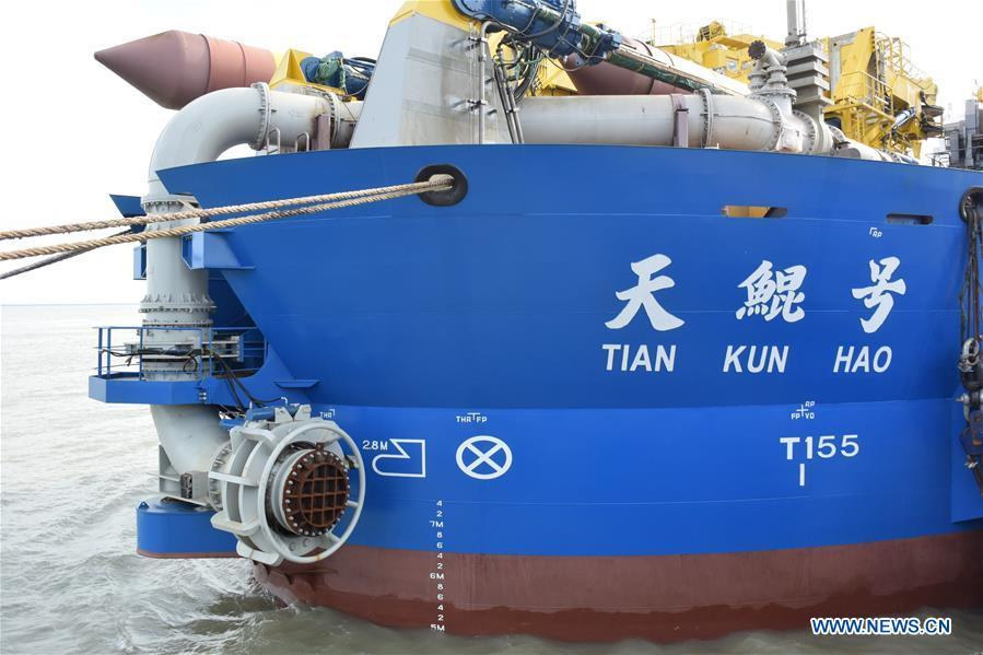 Tian Kun Hao, a Chinese-built dredging vessel, the largest of its kind in Asia, berths at a port in Qidong City, east China\'s Jiangsu Province, June 7, 2018. Tian Kun Hao, constructed by Tianjin Dredging Co. Ltd., a subsidiary of China Communication Construction Co., Ltd. (CCCC), finished its first sea trial. The 140-meter-long vessel, with the designed capacity to dredge 6,000 cubic meters per hour, can dig as deep as 35 meters under the sea floor. (Xinhua/Mao Zhenhua)