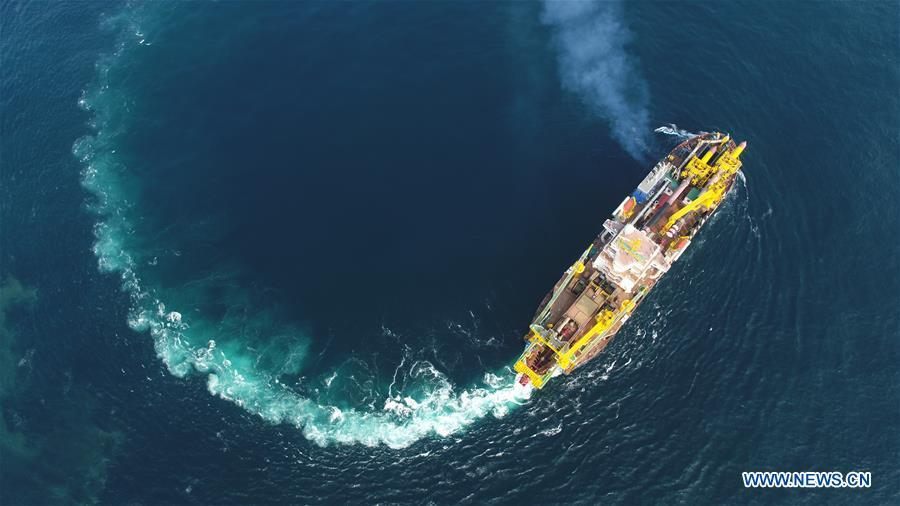 Tian Kun Hao, a Chinese-built dredging vessel, the largest of its kind in Asia, sails under a sea trial after departing a port in east China\'s Jiangsu Province, June 11, 2018. Tian Kun Hao, constructed by Tianjin Dredging Co. Ltd., a subsidiary of China Communication Construction Co., Ltd. (CCCC), finished its first sea trial. The 140-meter-long vessel, with the designed capacity to dredge 6,000 cubic meters per hour, can dig as deep as 35 meters under the sea floor. (Xinhua/Mao Zhenhua)