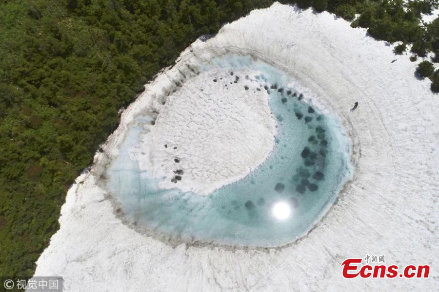 In this aerial image, Kagaminuma Pond is seen on June 5, 2018 in Iwate, Japan. Snow melting water creates an eye-shaped pond on the Hachimantai mountain.  (Photo/VCG)