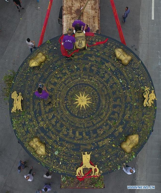 Photo taken on June 12, 2018 shows a giant bronze drum in Huanjiang Maonan Autonomous County, south China\'s Guangxi Zhuang Autonomous Region. The diameter of the drum is over six meters. It will be conveyed to Huazhumao plaza in Huanjiang. (Xinhua/Gao Dongfeng)