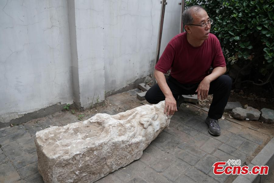 Four white marble building pieces are transported from the Qinghe Sub-district Administration Office in Haidian District, Beijing to the Older Summer Palace for preservation, June 12, 2018. The four cultural relics were found at a construction site in 2017, and experts believe they were originally part of buildings in the Old Summer Palace, a garden for the royal family during the Qing Dynasty (1644-1911) that was known as the \