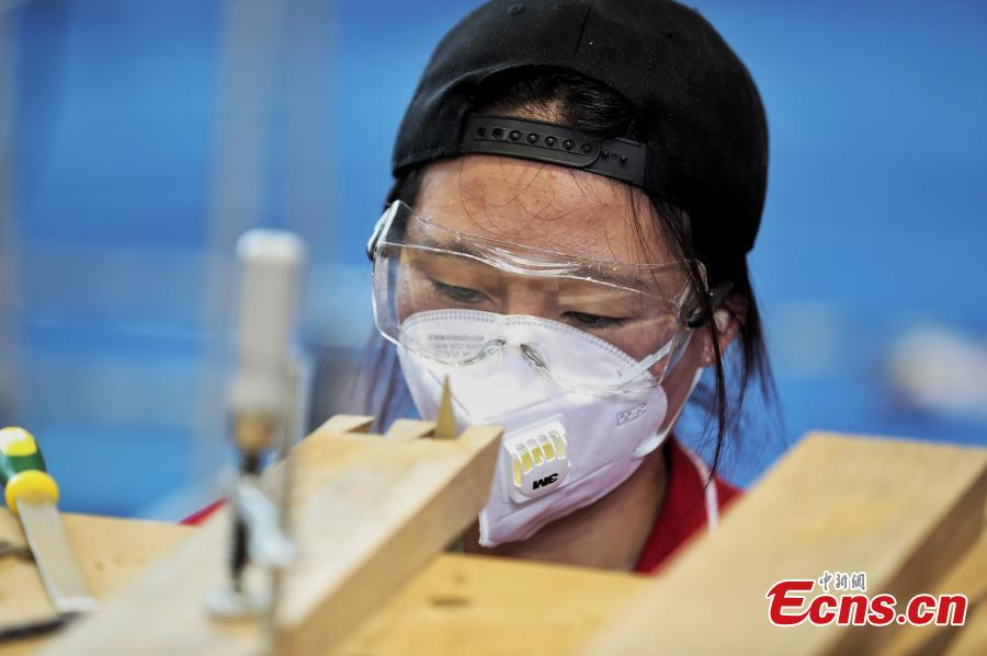 A scene from the WorldSkills China National Competition in Shanghai, June 13, 2018. A total of 897 skilled professionals from across the country will compete in 34 programs including carpentry, floriculture, gem cutting, baking and panel beating. The winners will represent China at the 46th WorldSkills Competition in 2021. WorldSkills aims to raise the profile and recognition of skilled people and show how important skills are in achieving economic growth and personal success, according to its official website. (Photo: China News Service/Zhang Hengwei)