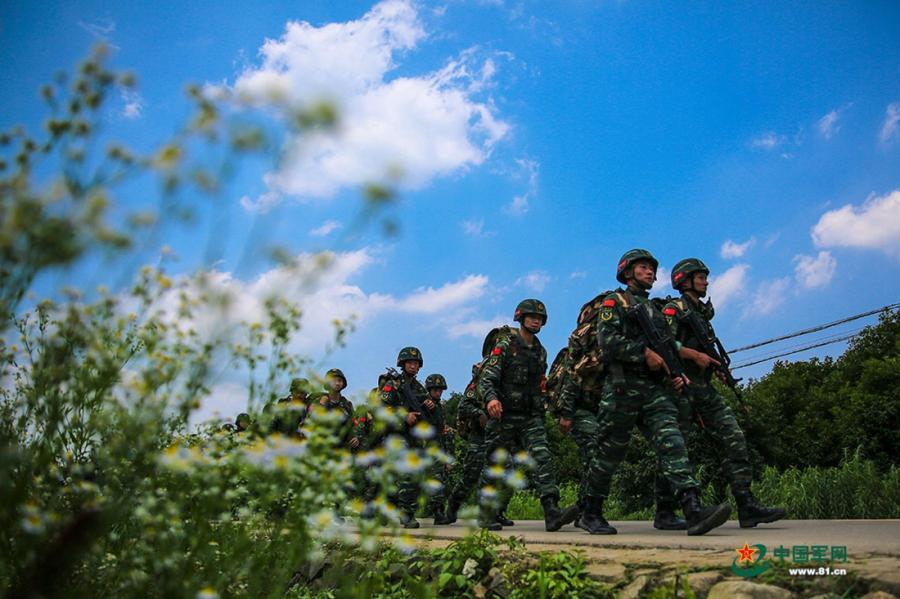 A group of soldiers march along a country road during the week-long rigorous training starting from June 11, 2018.  (Photo/81.cn)
