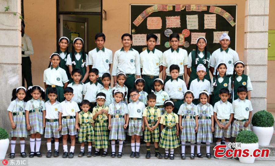 "The Green Land Public School in Pathankot in Punjab, India, is unique as it has 17 pairs of twins aged between three and 15. They are nearly all identical and look so same that even teachers are confused to identify who is who,"" said Dr. Jyoti Thakur, the principal of the school. (Photo/IC)"