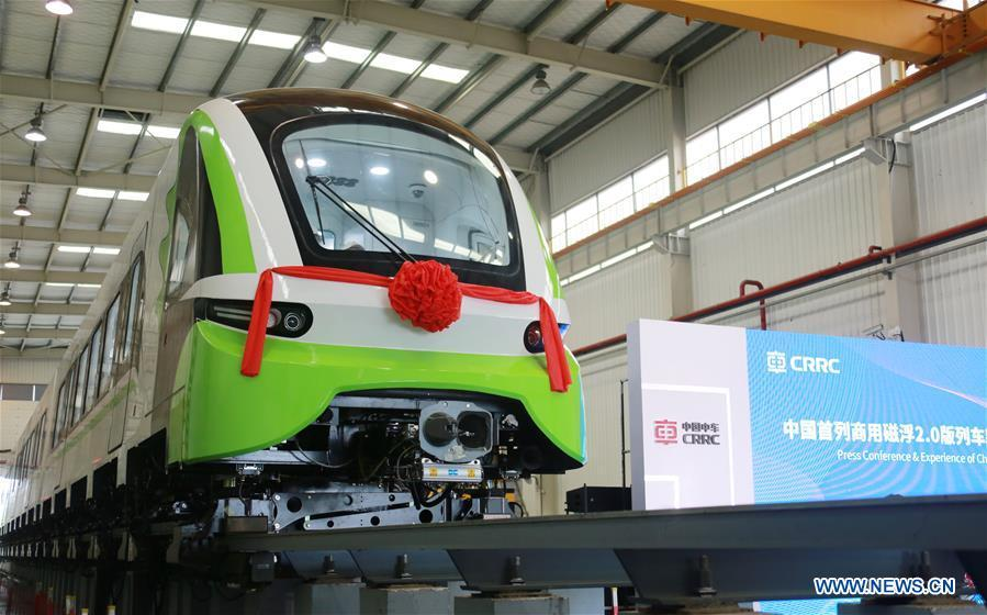 Photo taken on June 13, 2018 shows China\'s new generation domestic medium-low-speed magnetic levitation (maglev) train at the CRRC Zhuzhou Locomotive Co., Ltd., Zhuzhou of central China\'s Hunan Province. The new train rolled off the production line Wednesday and can run up to 160 km per hour, compared with the first generation\'s top speed of 100 km per hour. (Photo/Xinhua)
